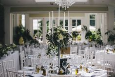 The brand new Orangery at Goldsborough Hall for Alix & Andy's wedding. Centrepieces by Lucy MacNicoll and image thanks to The Twins Photography
