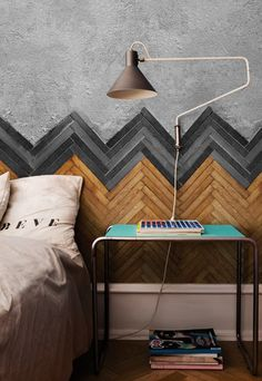 incredible wall treatment or headboard using flooring in a chevron pattern