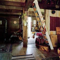Wish // For a cabin in the middle of nowhere... wooden ladder/steps, beams, eclectic rugs and art... from the book, Handmade Houses: A Guide to the Woodbutcher's Art by Art Boericke & Barry Shapiro.