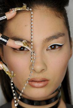 A model at #TheBlonds #NYFW runway shows off her CND custom #nails. #CNDatFashionWeek