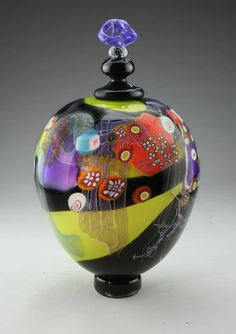 """""""Round Lidded Jar"""" created by Wes Hunting One of a Kind In Wes Hunting's hand-blown Color Field pieces, the artist draws onto the glass surface at temperatures exceeding 1600 degrees, incorporating colorful millefiore and floating pieces of cane."""