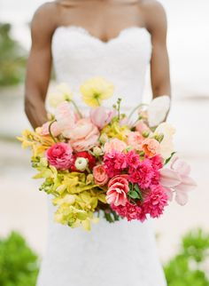 Pink and yellow bright wedding bouquet: http://www.stylemepretty.com/2017/04/19/colorful-jamaica-wedding-designed-with-effortless-island-elegance/ Photography: Sylvie Gil - http://www.sylviegilphotography.com/