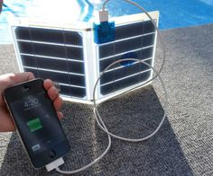 What better way to go green when everyone else is turning decomp brown?    Survivalist Solar Phone Charger | DudeIWantThat.com