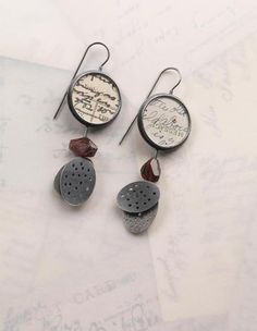 3 part earrings   oxidised silver, old postcards, garnets, gold, perspex   by Clare Hillerby