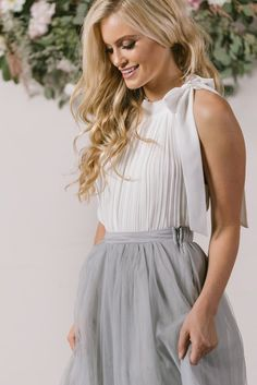 This pleated beauty is the perfect top for all of the midi and maxi skirts sitting in your closet. We...