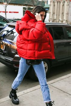 Kendall Jenner in a bubble jacket and black boots for the winter.