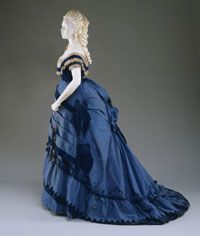 1870    Artist/maker unknown, American. Worn by Mrs. John Cadwalader (Mary Helen Fisher), Philadelphia.    Bright blue silk faille and velvet trimmed with ivory silk net ruching.  Bodice (a, Center Back Length): 8 inches (20.3 cm) Bodice (b, Center Back Length): 24 inches (61 cm) Skirt (Center Back Length): 63 inches (160 cm) Skirt (Waist): 24 inches