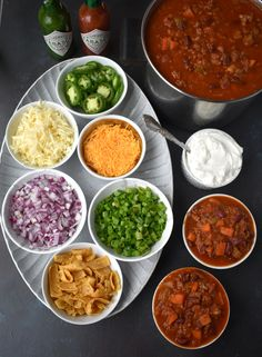 The Ultimate Chili Bar features a spicy turkey chili and all the toppings including shredded cheese, red onions, jalapenos, hot sauce, corn. Chili Bar Party, Slow Cooker Chili, Taco Bar, Appetizers For Party, Appetizer Recipes, Sour Cream, Chili Toppings, Do It Yourself Food, Corn Chips