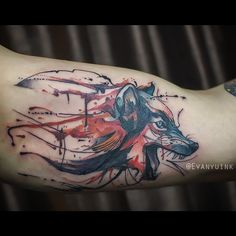 Watercolour/paint style wolf in the inner bicep. #tattoo #ink #wolf #wolftattoo #watercolor #watercolour #watercolortattoo #art #illustration #paint #animal #chronicink
