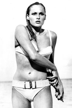 Ursula Andress, Dr. No,1962.  The first-ever Bond girl, set the bar pretty high. As Honey Rider, Andress stepped out of the Caribbean and into the fantasies of every guy longing to be James Bond. The matching knife belt was a cute touch.