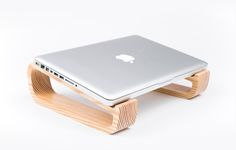 A versatile and portable laptop stand, made from pinewood with love and care for people and nature.