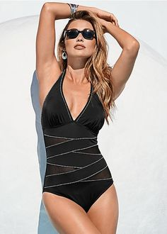 The suit for the girl who wants to show just a little something. Venus peek a boo halter one-piece.