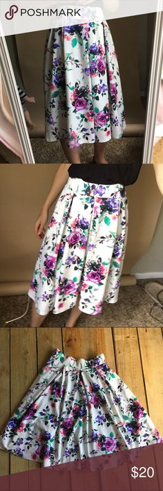 Red Lolly floral midi skirt Skirt is in great condition. Material is 96%polyester and 4% spandex. Hits me right below the knee when worn at my natural waist. The skirt has a wide elastic band at the waist and a few pleats red lolly Skirts Midi