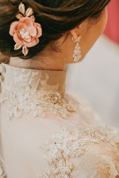 Elegant champagne cheongsam dress for this bride #qipao and sparkly hair accessories and earrings // Hall of Mirrors: Jin and Su's Glamorous Wedding at the Grand Hyatt Kuala Lumpur