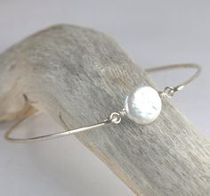 Hey, I found this really awesome Etsy listing at https://www.etsy.com/listing/182591099/white-pearl-sterling-silver-bangle