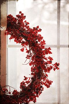 Red berry wreath  via Kaille Mazurowski