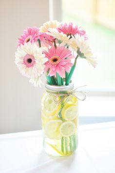 Gerbera Daisies in Mason Jar with Lemons - perfect summertime centerpiece!