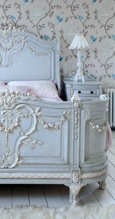 Beautiful blue and white painted wooden bed and nightstand with blue  and white wallpaper