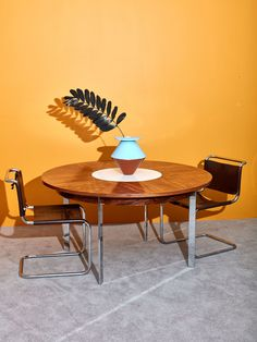 """Iconic vintage 1970's Milo Baughman dining table with built-in lazy susan. Extremely rare and special collectors item featuring sleek chrome legs, rosewood veneered top, and built in white revolving server. This stunning dining table was meticulously designed to last timeless generations. In great vintage condition. 28"""" H x 54"""" DIA Monthly Payments with Affirm available at checkout. *Shipping rates do not accurately represent shipping costs for furniture. Contact shipping@comingsoonnewyork.com f Round Dining Table, Dining Room Table, Lazy Susan Table, 1970s Furniture, Milo Baughman, Dining Room Inspiration, Living Room, 2020 Vision, Design"""