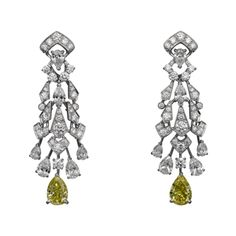 L'Odyssée de Cartier Parcours d'un Style High Jewelry earrings in platinum with pear-shaped diamonds, pear-shaped yellow diamonds, brilliants.
