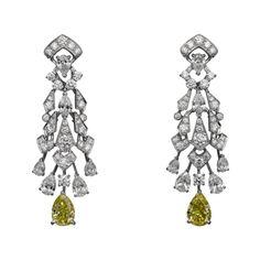 L'Odyssée de Cartier Parcours d'un Style High Jewelry earrings in platinum with pear-shaped diamonds, pear-shaped yellow diamonds, brilliants.