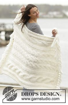 """Frosty Cables - Set consists of: Knitted DROPS blanket and pillow with cables in """"Polaris"""". - Free pattern by DROPS Design"""
