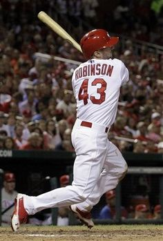 Shane Robinson follows through on a three-run triple during the fifth inning of a baseball game against the Philadelphia Phillies..Cards won the game 11-3.  7-24-13