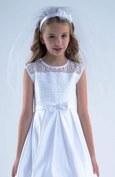 Add a bit of garden-inspired beauty to her communion outfit with this beaded flower headband and tulle veil. By Us Angels Polyester 26 L Imported Flower Girl Headbands, Ribbon Headbands, Flower Girl Dresses, Communion Hairstyles, First Communion Veils, Hat Hairstyles, Davids Bridal, Beautiful Dresses, Bridesmaid Dresses