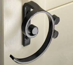 Cupboard handles (bass clef & treble clef designs) @Rebecca Jordan we need these for our janked cabinets :)