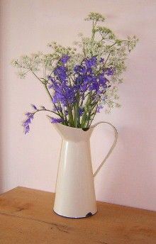 I have an assortment of enamel jugs for my table centres  Google Image Result for http://www.southwestpine.co.uk/webupload/SWPINE/CUSTOM/REX-GIFTWARE/SMALL/jug-with-flowers.jpg