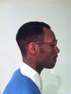men afro fade parting hairstyle