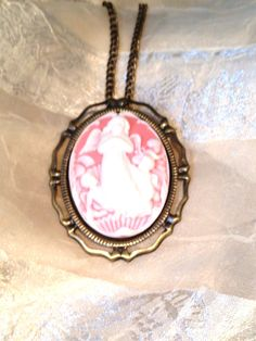 Guardian Angel #Cameo #Necklace / #Brooch - Convertible 2 in 1 by NorthCoastCottage, $39.00  Stately, with a #retro #vintage feel, an #heirloom to be cherished forever. #Children look to #heaven and see a beautiful #guardian #angel representing maternal love and #memories that never die. A perfect #MothersDay #gift, #sympathy #keepsake for a loved one in #mourning, or comforting personal remembrance. Honors the #goddess in our #mothers and #grandmothers. Very detailed and fine. Please repin…