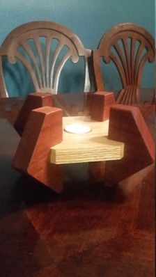 Enjoy this decorative tea light candle holder. Made from Sapele and Pine wood.
