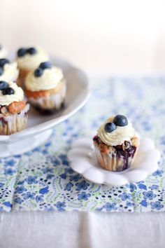 little blueberry cupcakes | CAKE: http://www.eatingwell.com/recipes/blueberry_cupcakes.html FROSTING: http://allrecipes.com/Recipe/Whipped-Cream-Cream-Cheese-Frosting/