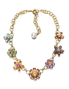 Dolce & Gabbana earrings, necklaces, pendants and rings with flowers anda various gemstones in settings decorated with floral motifs. Jewelry 2014, High Jewelry, Jewelry Trends, Jewelry Collection, Jewelry Necklaces, Jewellery, Jewelry Box, Dolce And Gabbana Earrings, Gold Earrings