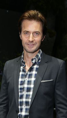 Richard Armitage, his hair is a bit poofy here, not really sticking up, but close enough. :)