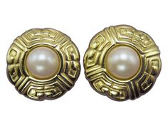 Pearls pop up in the center of vintage designer Givenchy classic clip earrings.