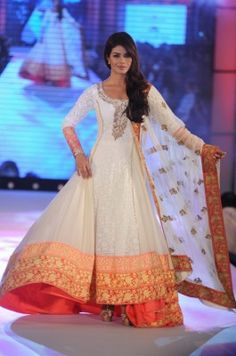 Priyanka Chopra the #DesiGirl takes up to the ramp with a flaunting long Indian dress.