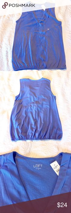Adorable LOFT V-neck Tank/Shell An absolutely adorable mixed media sleeveless shell by LOFT of Ann Taylor that features a V-neck with ruffle detail down the front. A light elastic gathered waist band. Wear alone, with a shrug or cute light Cardigan; dress up or down ..a truly versatile tank!! Body: 100% cotton; front: woven 100% polyester.  Color: Serene Blue. NWT. OFFERS WELCOME BUNDLE AND SAVE 15% LOFT Tops Tank Tops