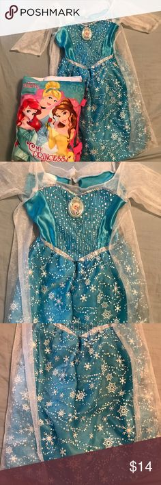 Singing Frozen Elsa Dress 4-6x With Sheer Cape Disney store costume Singing Elsa dress from Frozen. Has attached Sheer white cape and Sheer arms. Fits most girls size 4-6x. Has silver sequins and silver glitter snow flakes. Battery pack on inside in comfy soft pouch for comfort. Can be turned on and off and to test mode. Great for Halloween or just for dress up. Disney Costumes Halloween