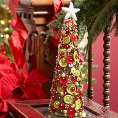 Holiday Button Tree--just use sewing pins to attach buttons to a foam cone. They look like snow!