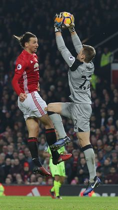 Zlatan Ibrahimovic of Manchester United in action with Simon Mignolet of Liverpool during the Premier League match between Manchester United and...