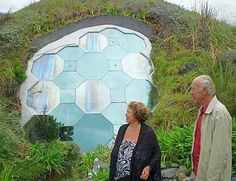 The Fritz Eisenhofer underground dome home in New Zealand is actually five cement domes interconnected 12-feet below the surface (pictured).      This dome home actually has one huge south-facing window peaking out from beneath the Earth surface catching the sunlight.
