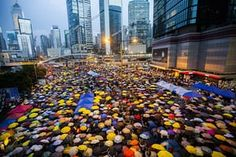 Pro-democracy protesters in Hong Kong open their umbrellas for 87 seconds, marking the 87 rounds of teargas fired by police at unarmed student protesters in the same location one month ago. The Admiralty district protest zone has been dubbed Umbrella Square.