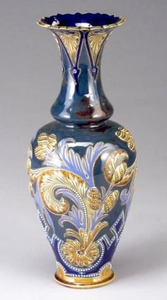A Doulton Lambeth, by Eliza Simmance Vase, with flaring rim, decorated with acanthus leaves and pods in ambers and blues, England, circa 1875-1930