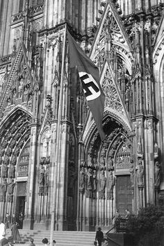On October 26, 1935, the Catholic Church reached an accord with the Nazi government over flags . From then on, the papal flag would fly over churches on church holidays, while the Nazi flag would fly on state holidays. The flags were never to fly at the same time. This deal was made personally between Adolf Hitler and Bishop Conrad von Presying of Berlin. Here, the swastika flutters over the Cologne Cathedral.