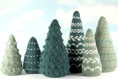 "Knit a whole grove of serene and stately firs in celebration of winter or to welcome the holidays. Embellishments include a choice of bobbles, Fair Isle designs, or beads. In two heights, 5"" and 7""."