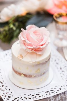 Mini wedding cake with pink sugar rose and gold flecks