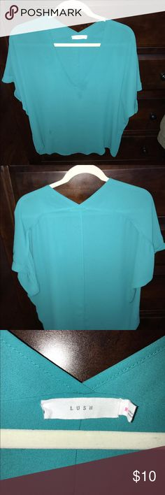 Lush teal v neck blouse. Flowy, low neck. Very pretty. Cuffed short sleeves. First pic is to show fit (different color) Lush Tops Blouses