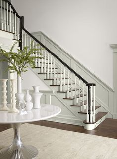 Entryway in a neutral paint colors palette. Benjamin Moore Stonington Gray stair risers, trim and wainscoting, walls Lacey Pearl, accent Almost Black Neutral Paint Colors, Interior Paint Colors, Foyer Paint Colors, Beige Paint, Hallway Wall Colors, Front Hallway, White Colors, Stain Colors, Interior Design